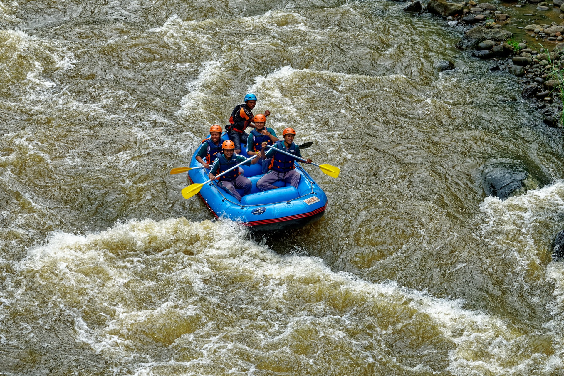 people-riding-on-inflatable-boat-1732278