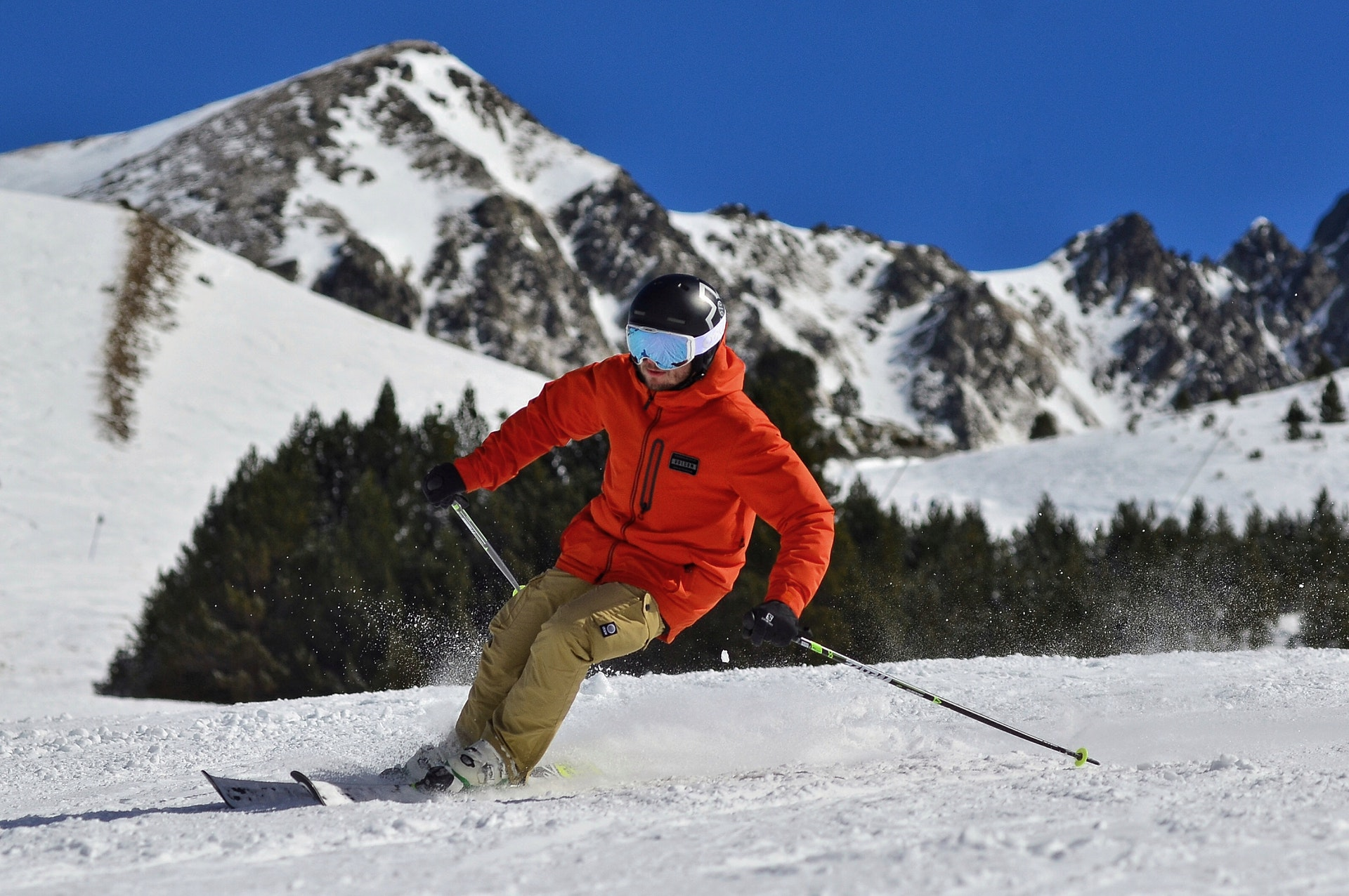 photo-of-a-man-in-an-orange-jacket-and-beige-trousers-skiing-3600571 (1)