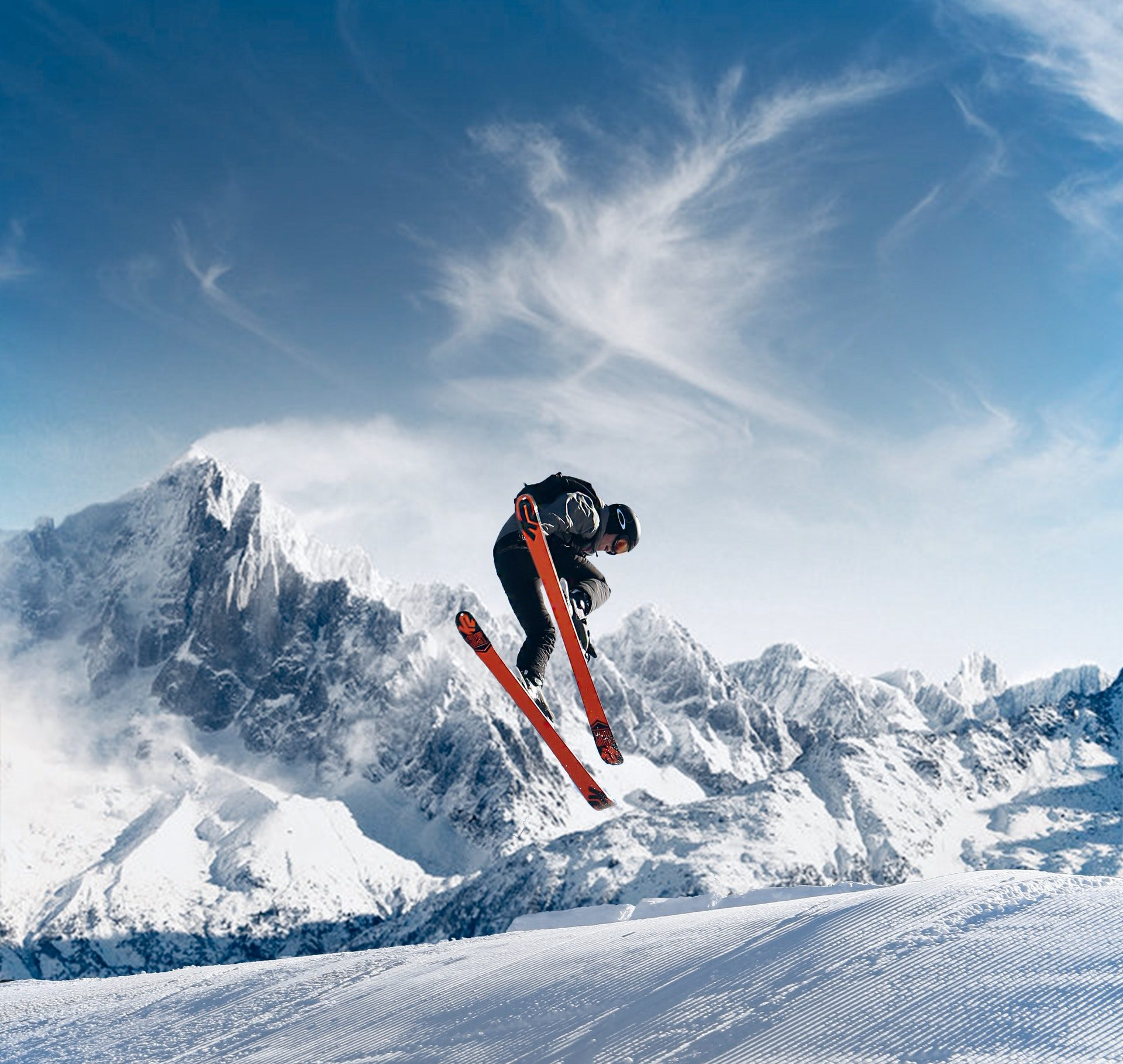 photo-of-person-skiing-on-snowfield-2433353